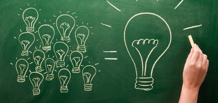 light bulbs sketched on chalkboard Many small ideas make a big one
